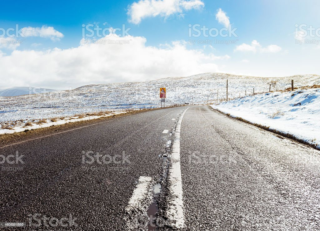 British country road in winter snow stock photo