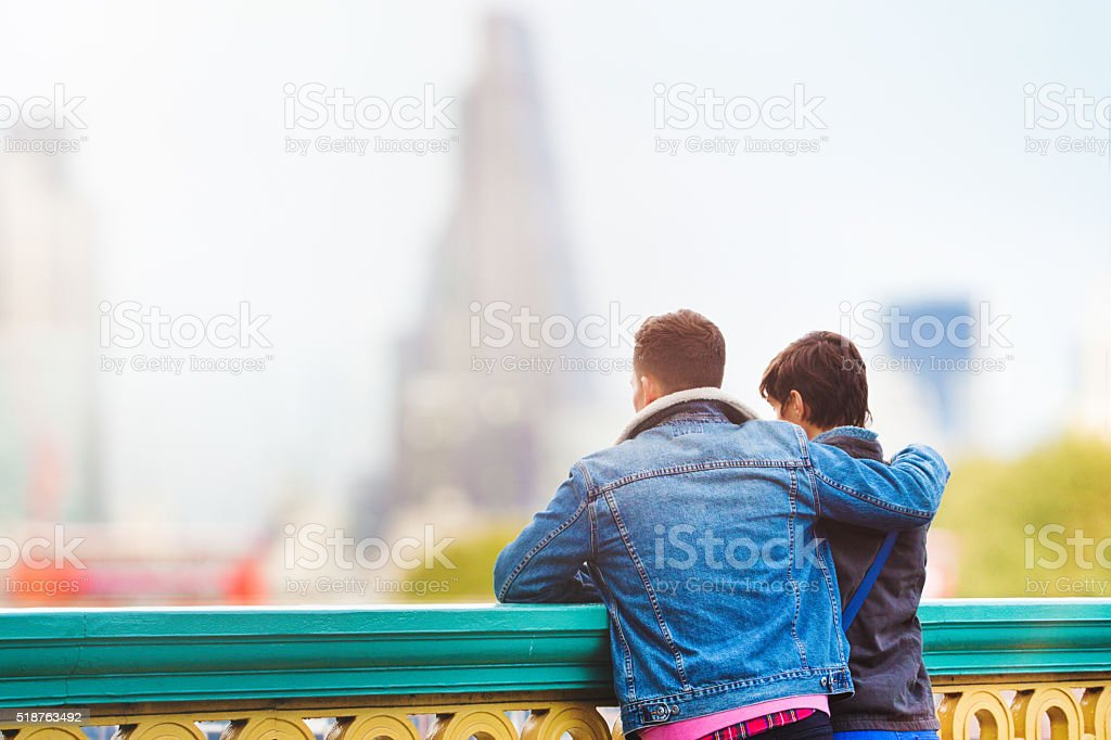 British couple looking at London Sunset by Thames stock photo