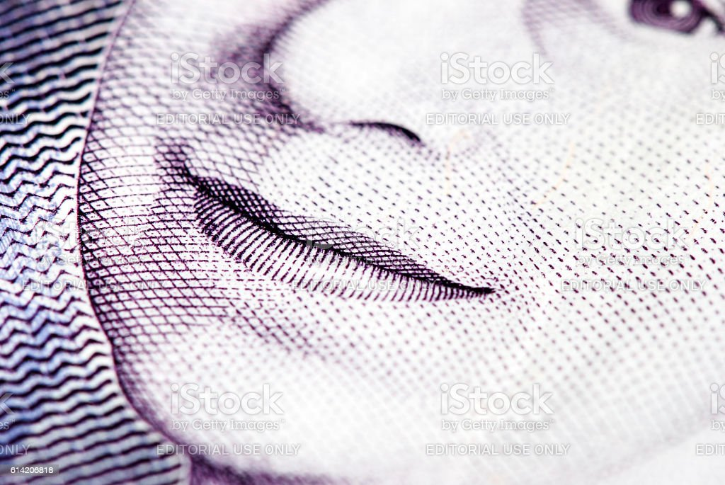 British currency closeup with Queen Elizabeth the second smile detail stock photo