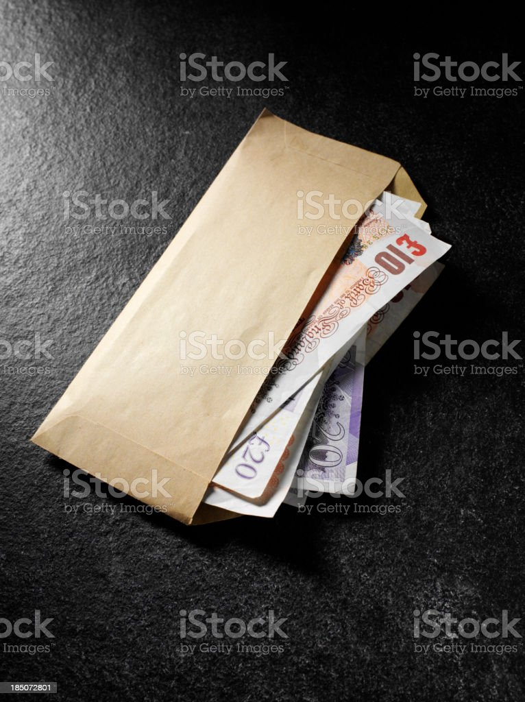 British Currency in a Brown Envelope royalty-free stock photo