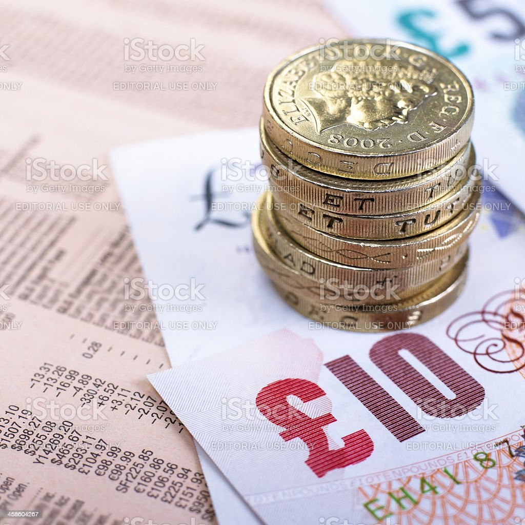 British currency on financial newspaper royalty-free stock photo