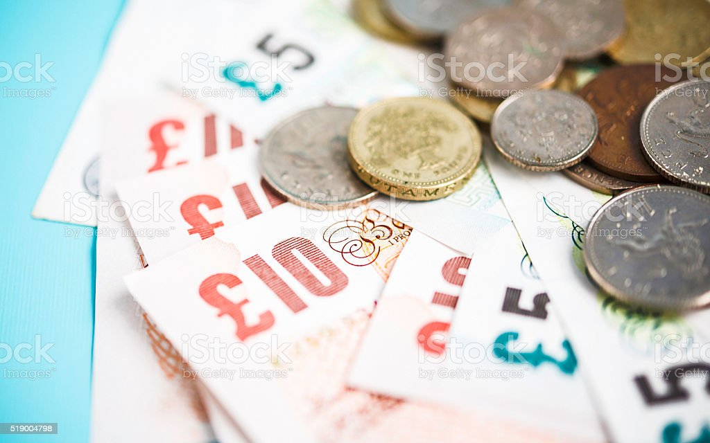 British currency pound notes and coins stock photo