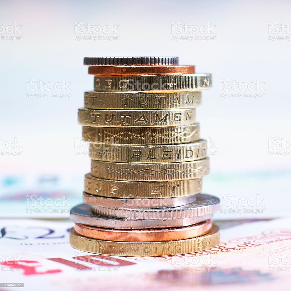British currency stacked in a pile stock photo