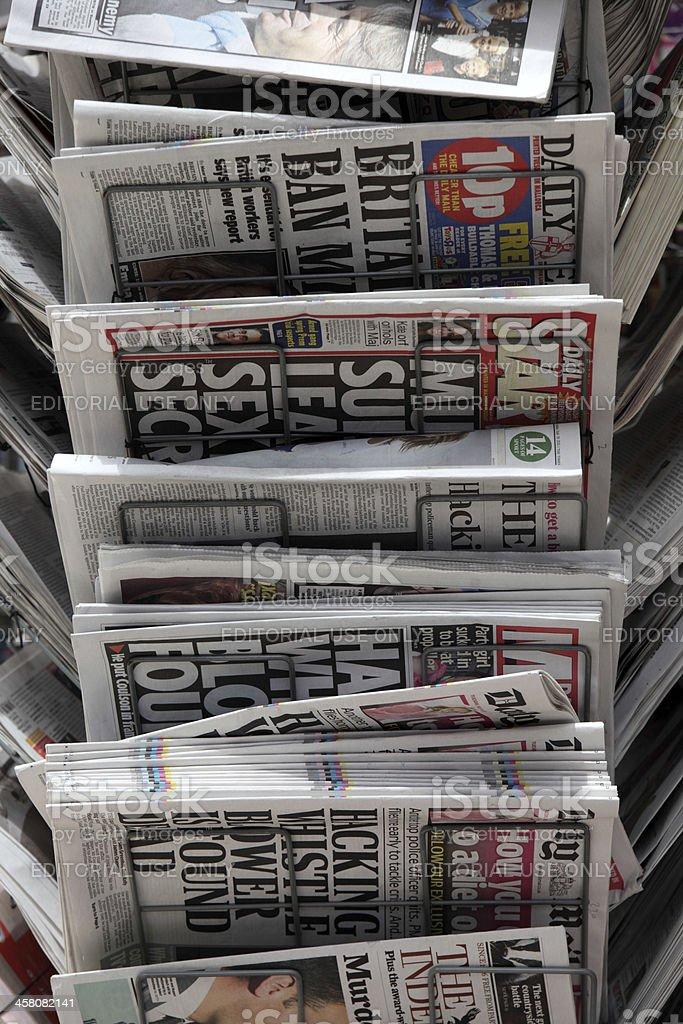 British daily newspapers in rack stock photo