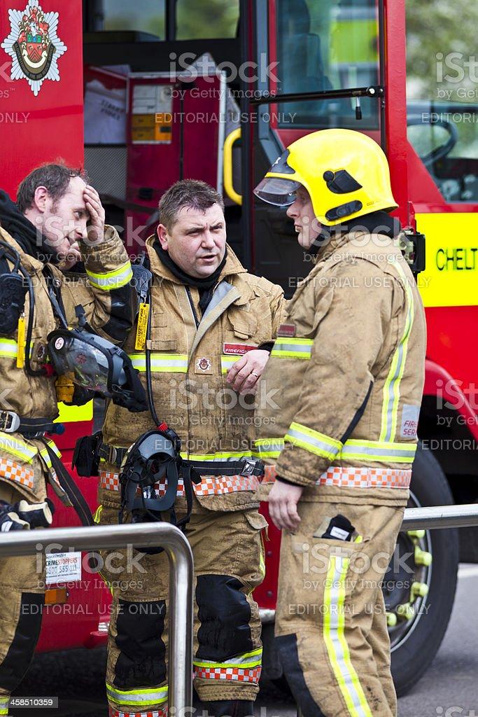 British firemen discussing action plan at blaze scene stock photo