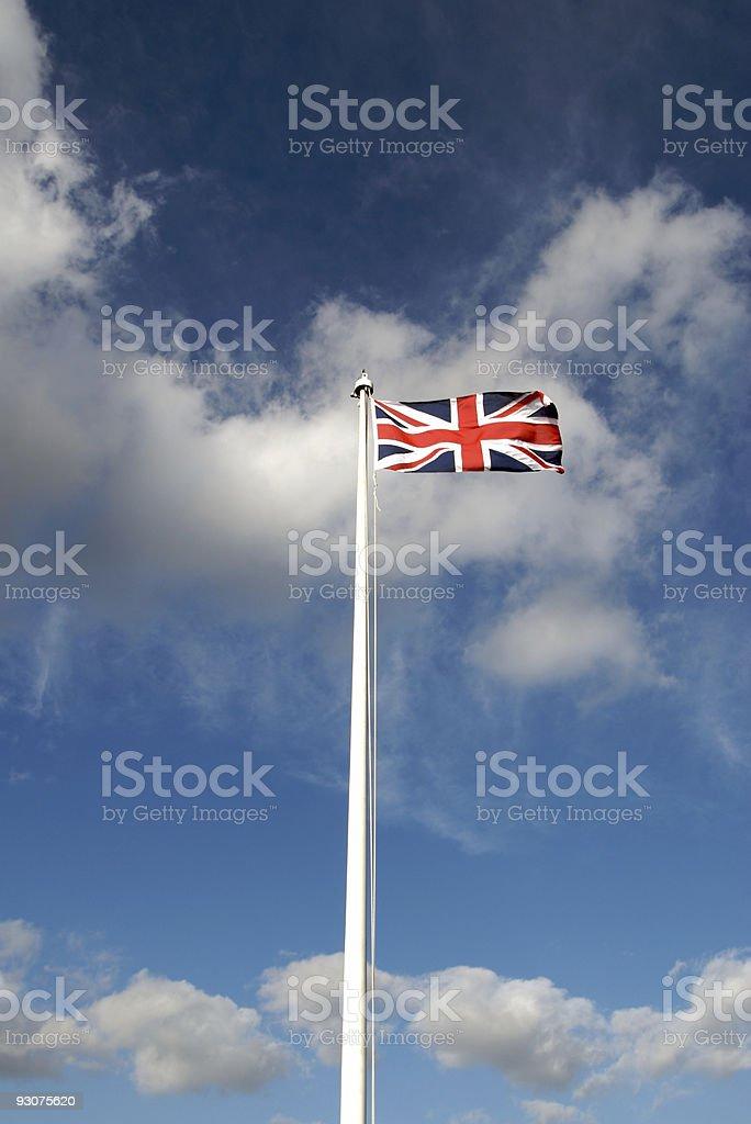 British Flag, Union Jack on pole, sky, vertical royalty-free stock photo