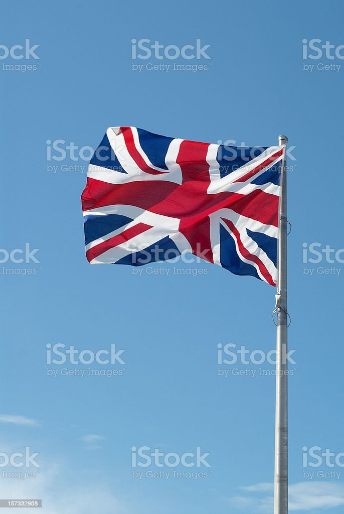 British flag with blue sky in background royalty-free stock photo