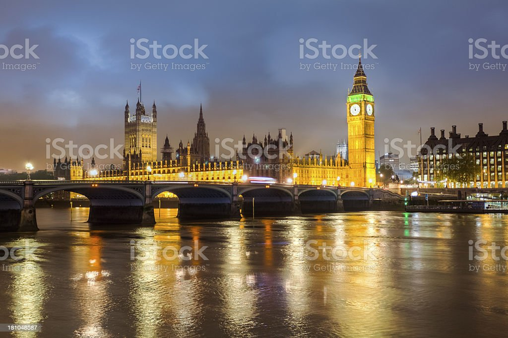 British House of Parliament with Reflections on Thames at Night royalty-free stock photo
