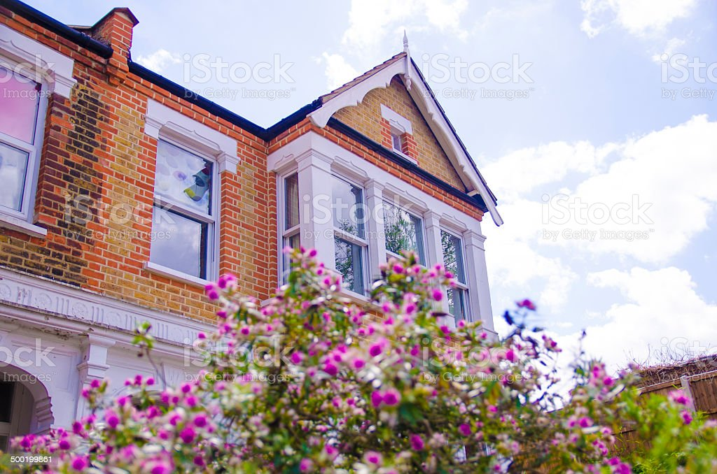 British house with flowers stock photo