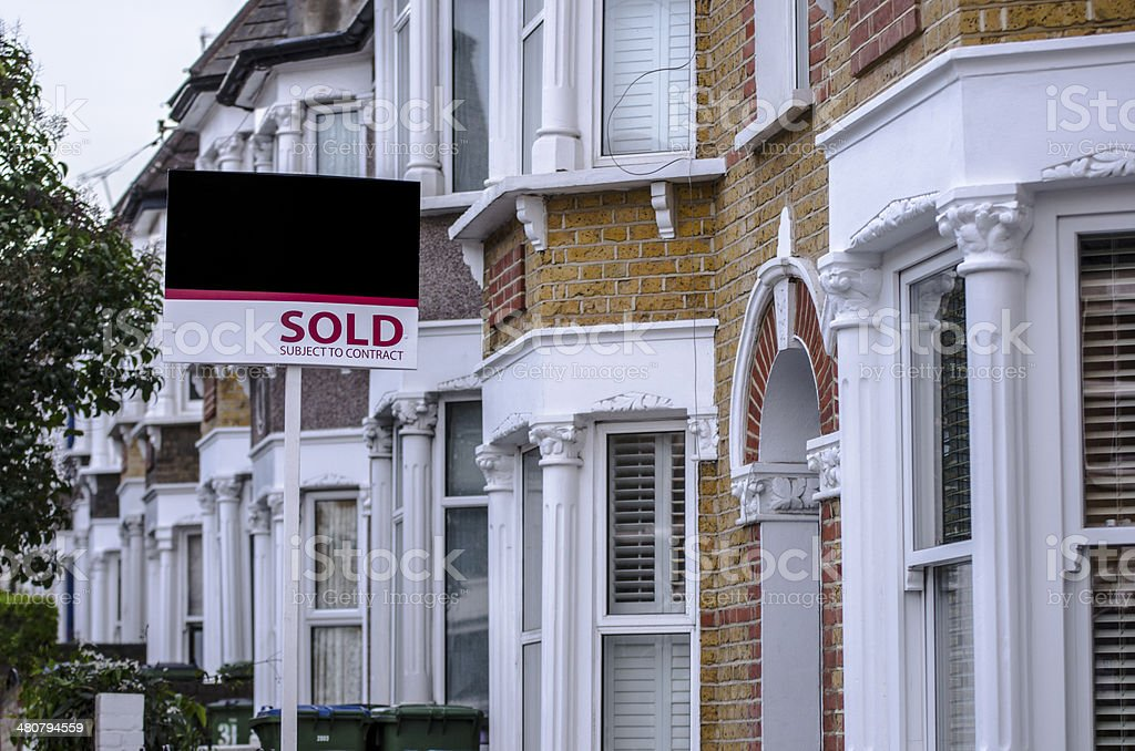 British houses with sold sign stock photo