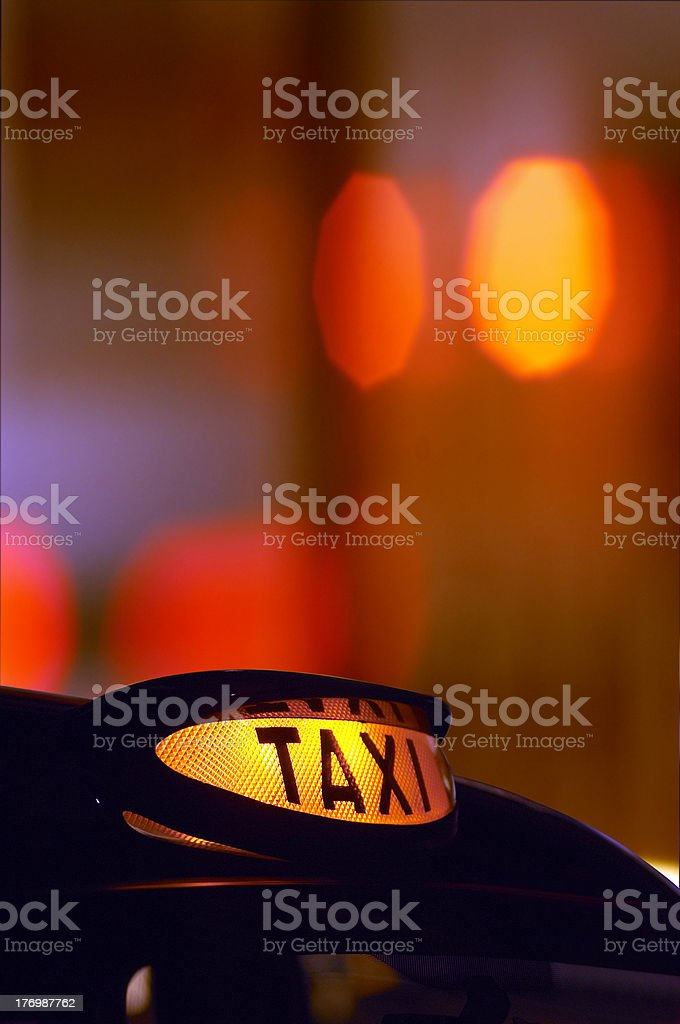 british london black taxi cab at night colorful background stock photo