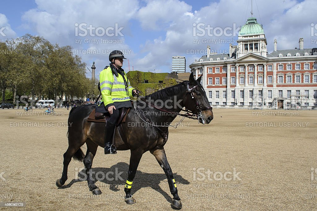 British policeman on horseback stock photo