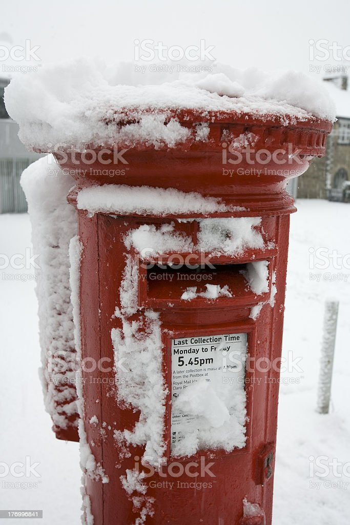 British post box in snow royalty-free stock photo