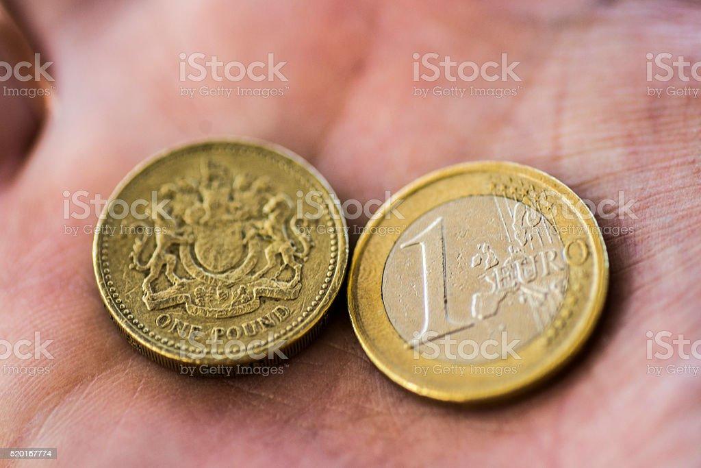 1 British pound and 1 euro stock photo