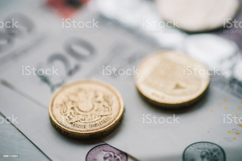 British pound coins and banknotes stock photo