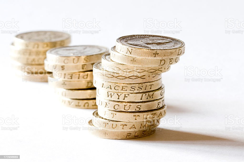 British pound coins stacked up stock photo