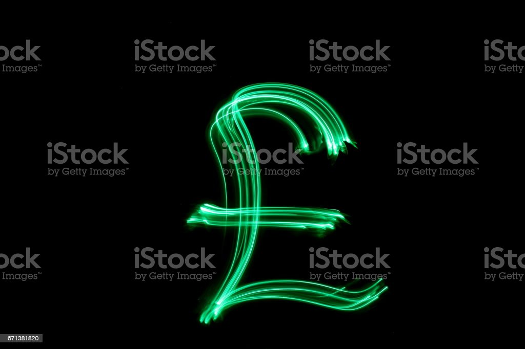 British pound sterling shape, Green Light Painting Photography stock photo