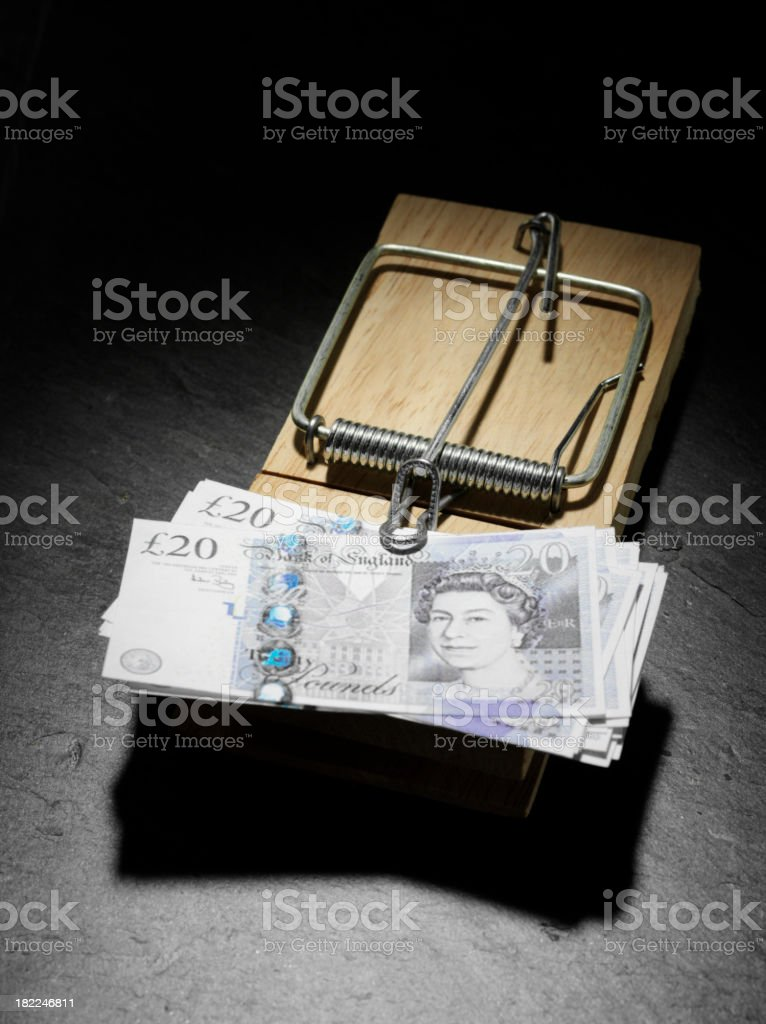 British Pounds in a Mousetrap stock photo
