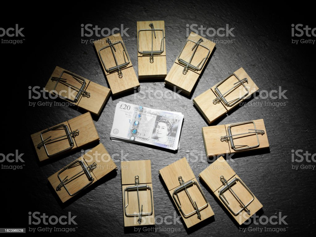 British Pounds Surrounded by Mousetrap royalty-free stock photo