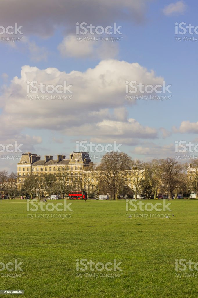 British red bus seen from a park in London stock photo