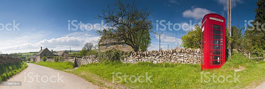 British red phone box country lane stock photo