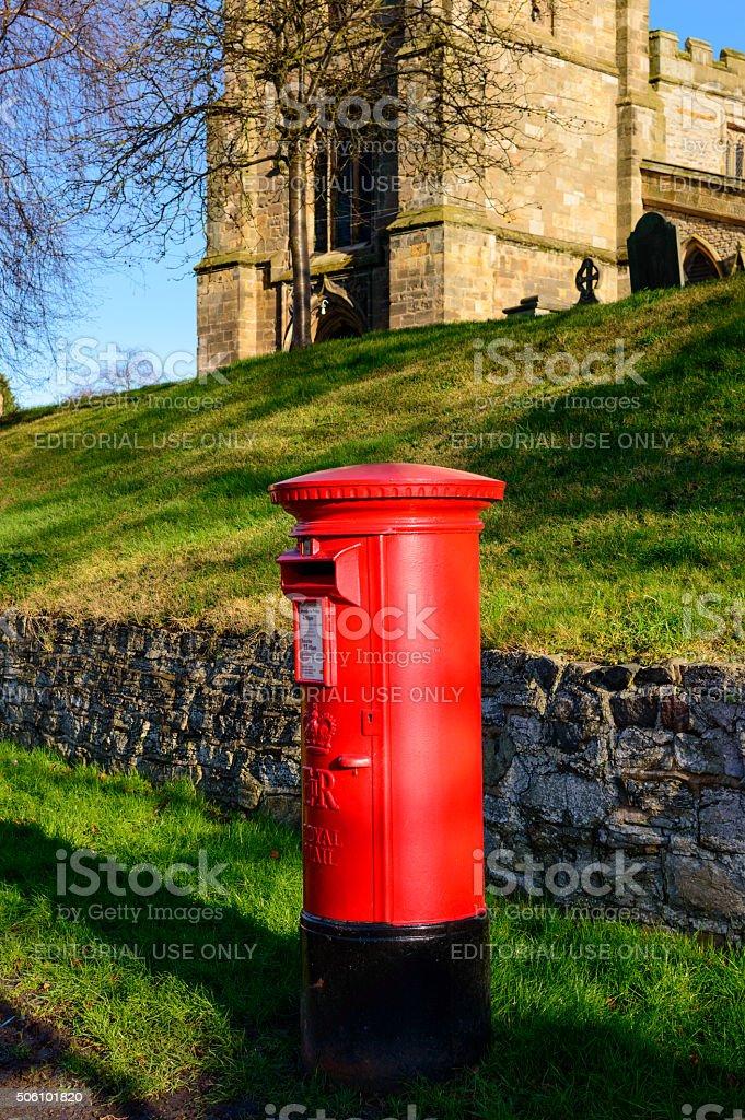 British red Royal Mail pillar box, near St Mary's Wymeswold stock photo