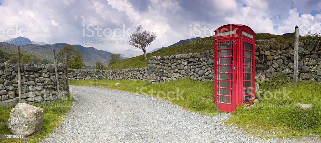 British Red Telephone Booth Near Dry Stone Walls royalty-free stock photo