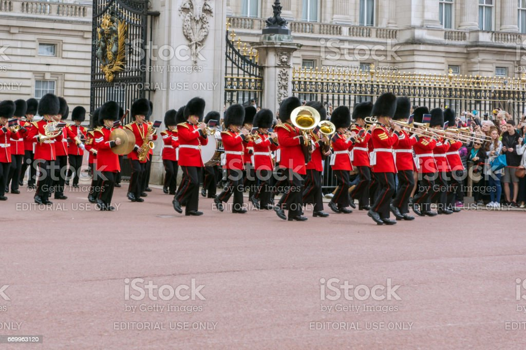 British Royal guards perform the Changing of the Guard in Buckingham Palace, London, Great Britain stock photo
