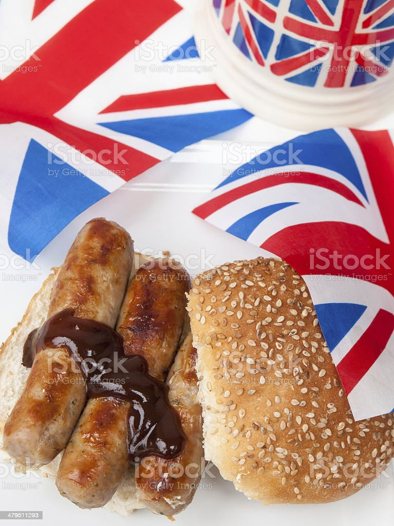 British sausage sandwich with brown sauce tea and flag stock photo