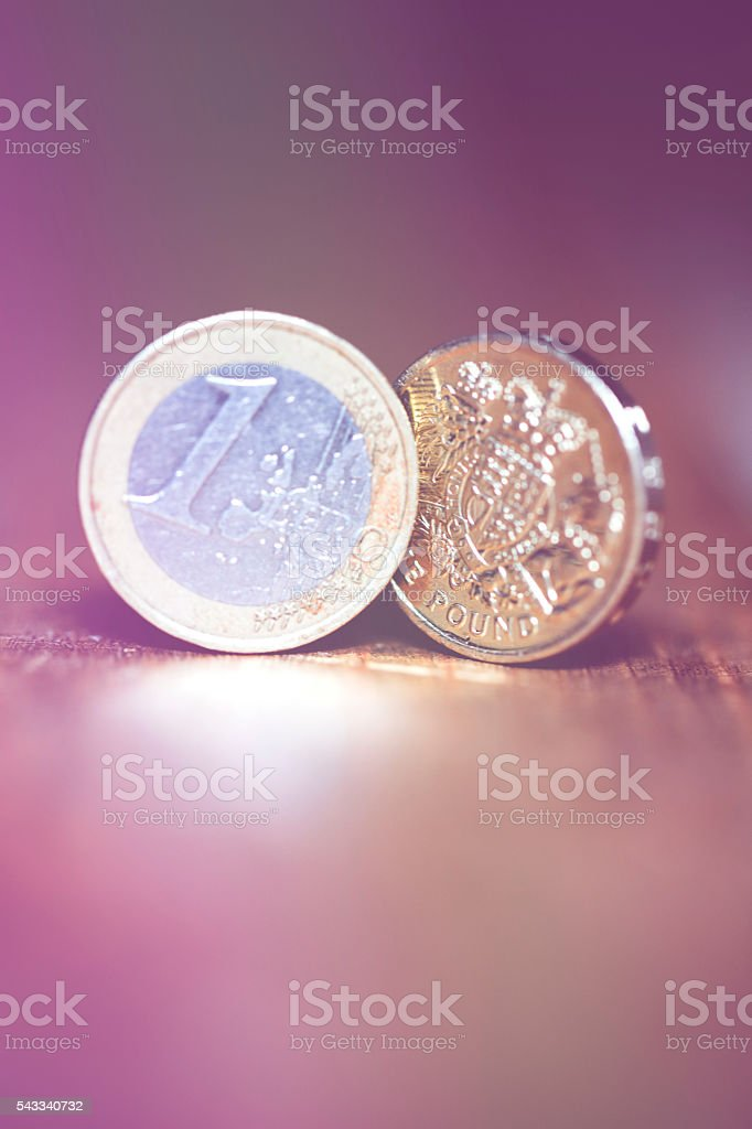 British sterling one pound coin and one Euro coin stock photo