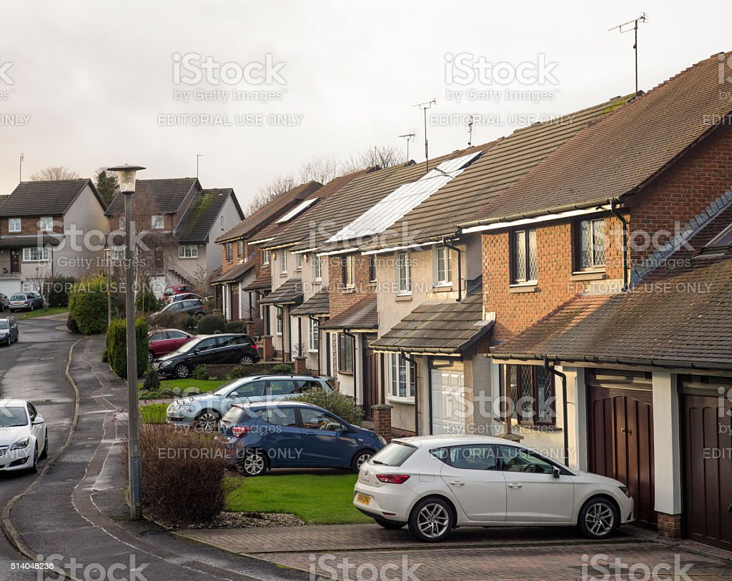 British suburban terraced houses with parked cars stock photo