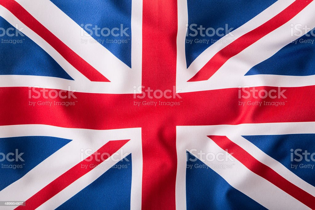 British Union Jack flag blowing in the wind. stock photo
