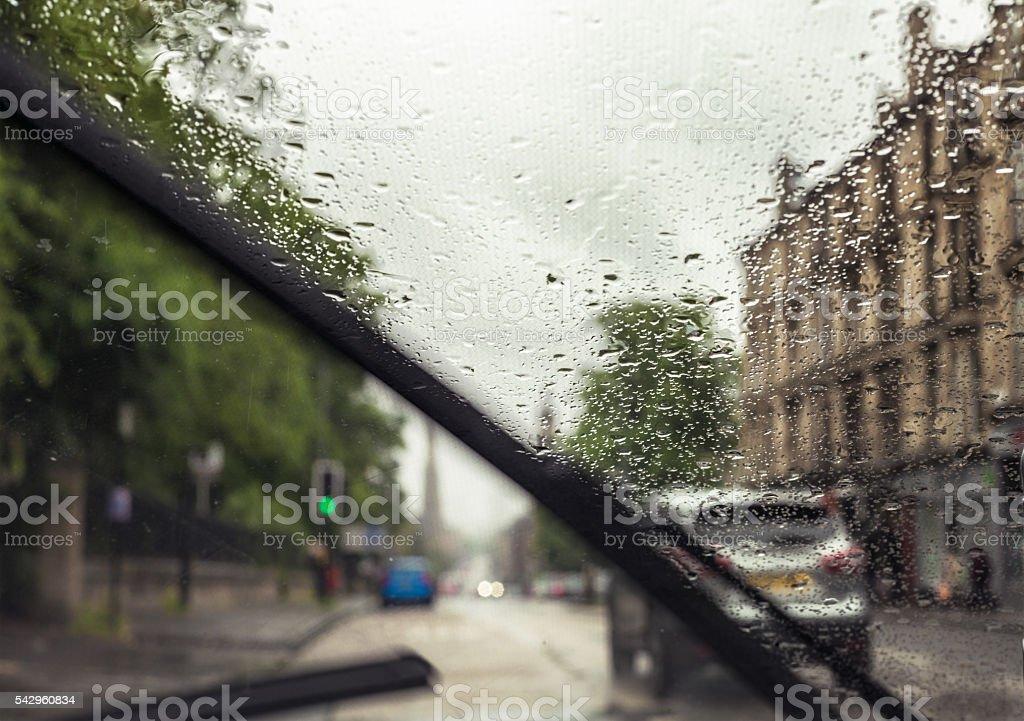 British urban driving in rainy weather stock photo