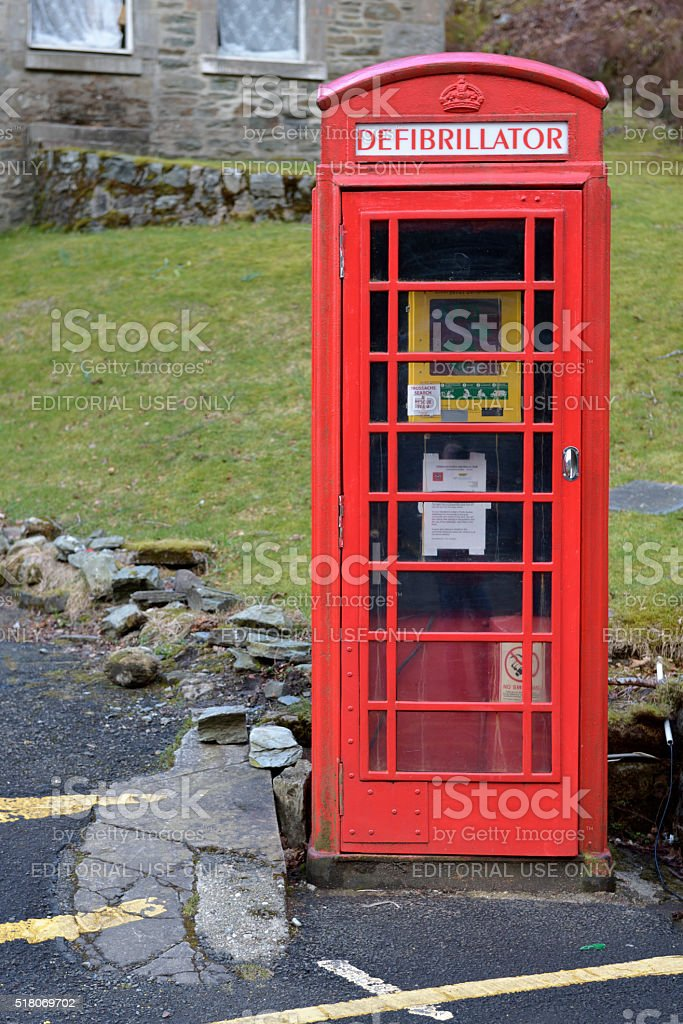 Britsh red telephone box coverted for an emergency defibrillator stock photo