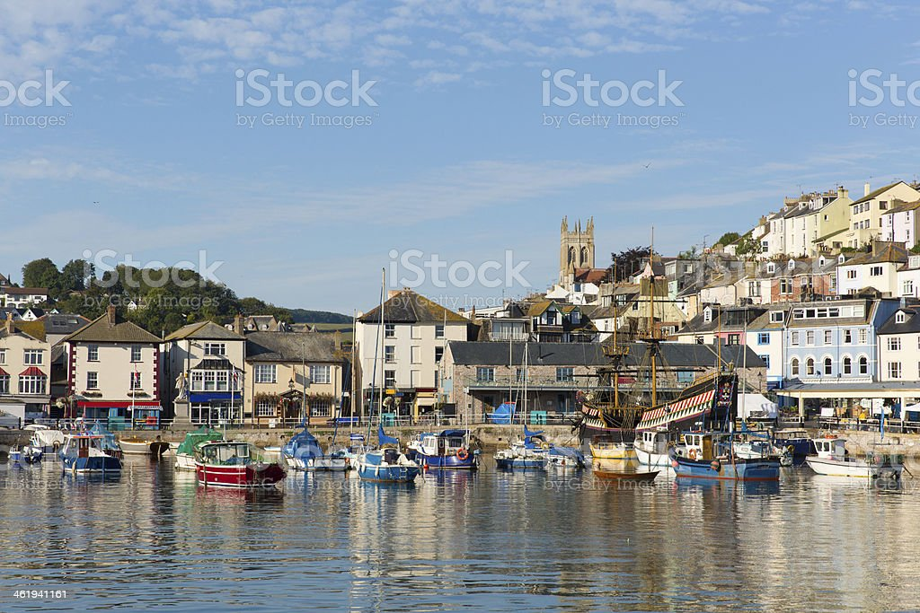 Brixham harbour Devon boats moored on still summer day stock photo