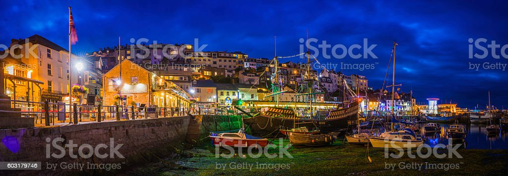 Brixham harbour picturesque fishing village illuminated dusk panorama Devon UK stock photo
