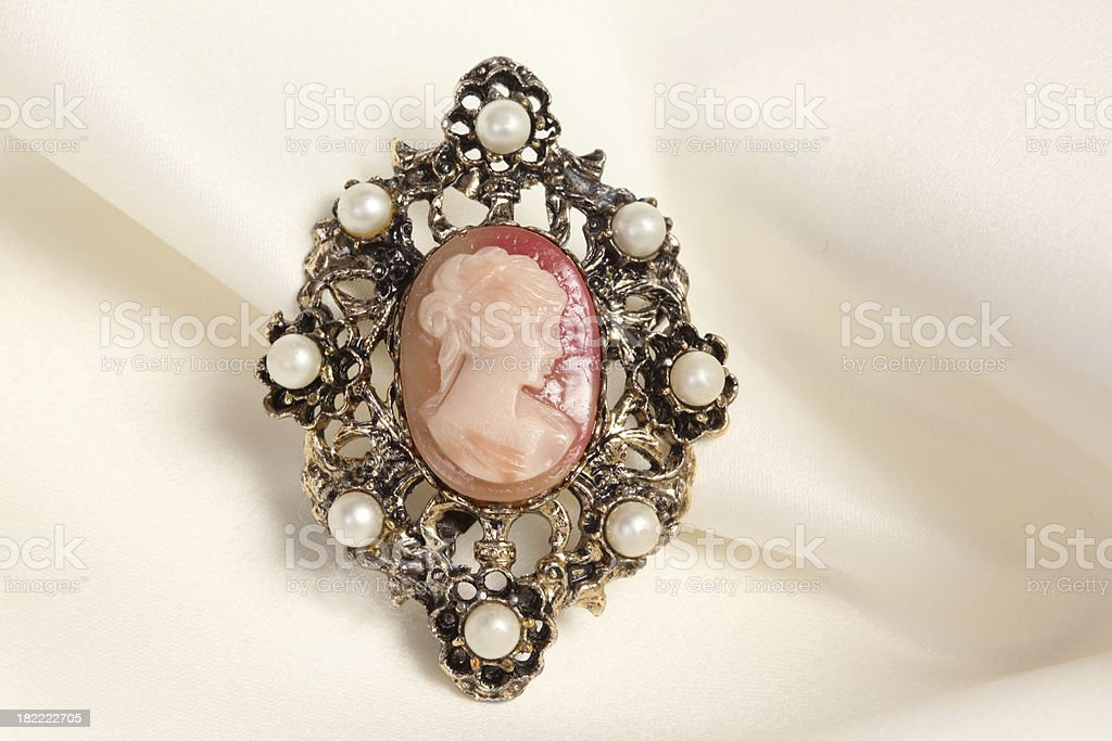 Broach on Satin background stock photo
