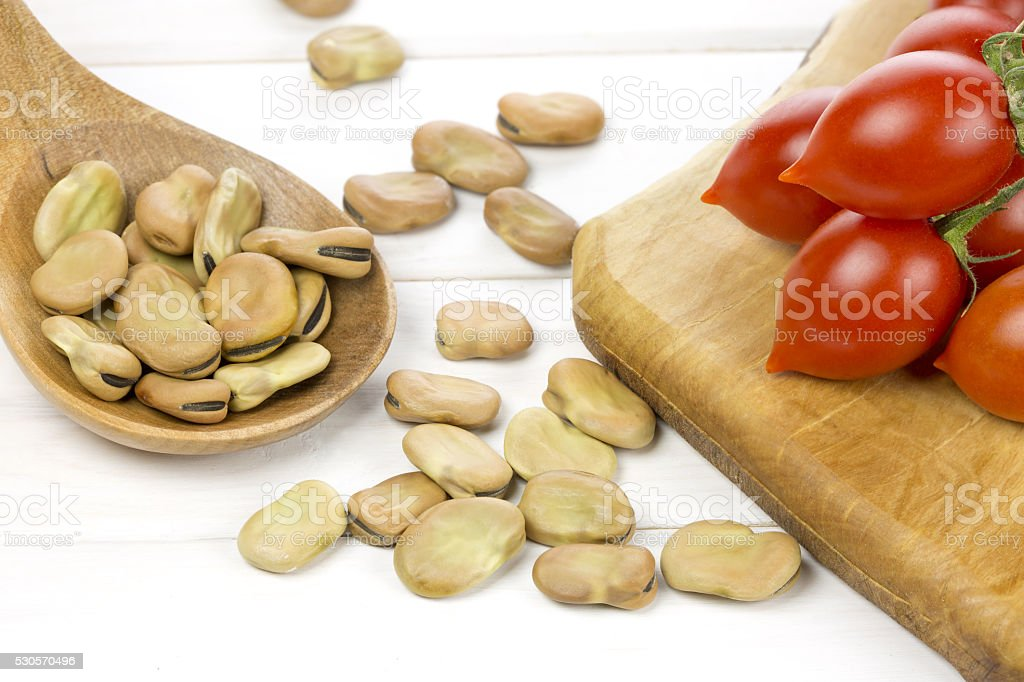 Broad beans and tomatoes stock photo