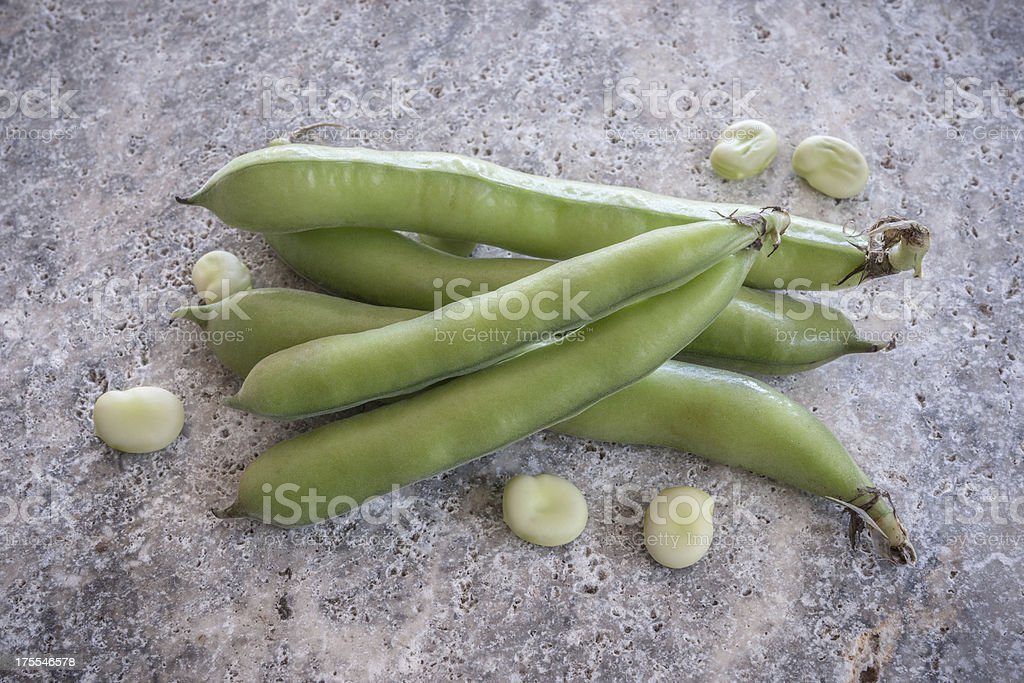Broad beans on a granite surface royalty-free stock photo