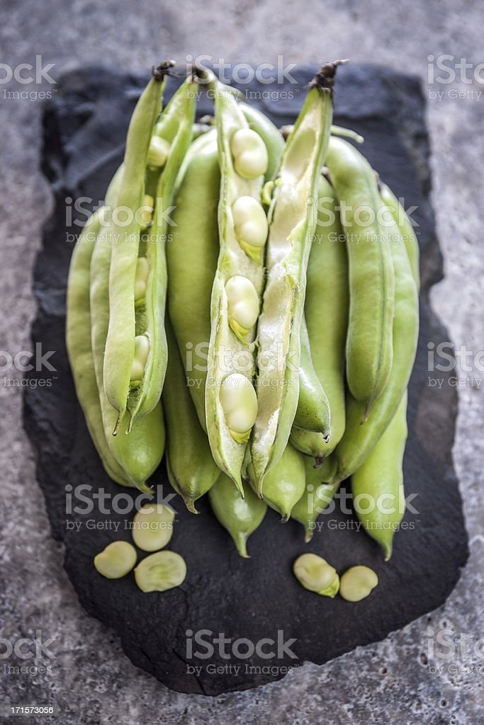 Broad beans on a slate surface royalty-free stock photo