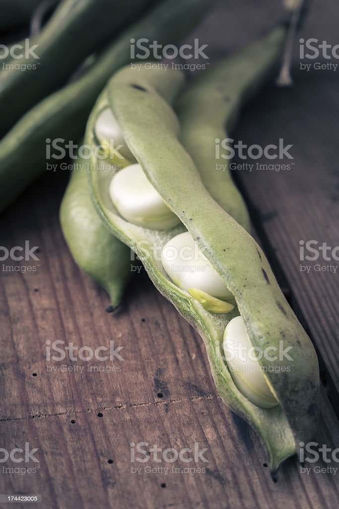 Broad Beans on a wooden Table royalty-free stock photo