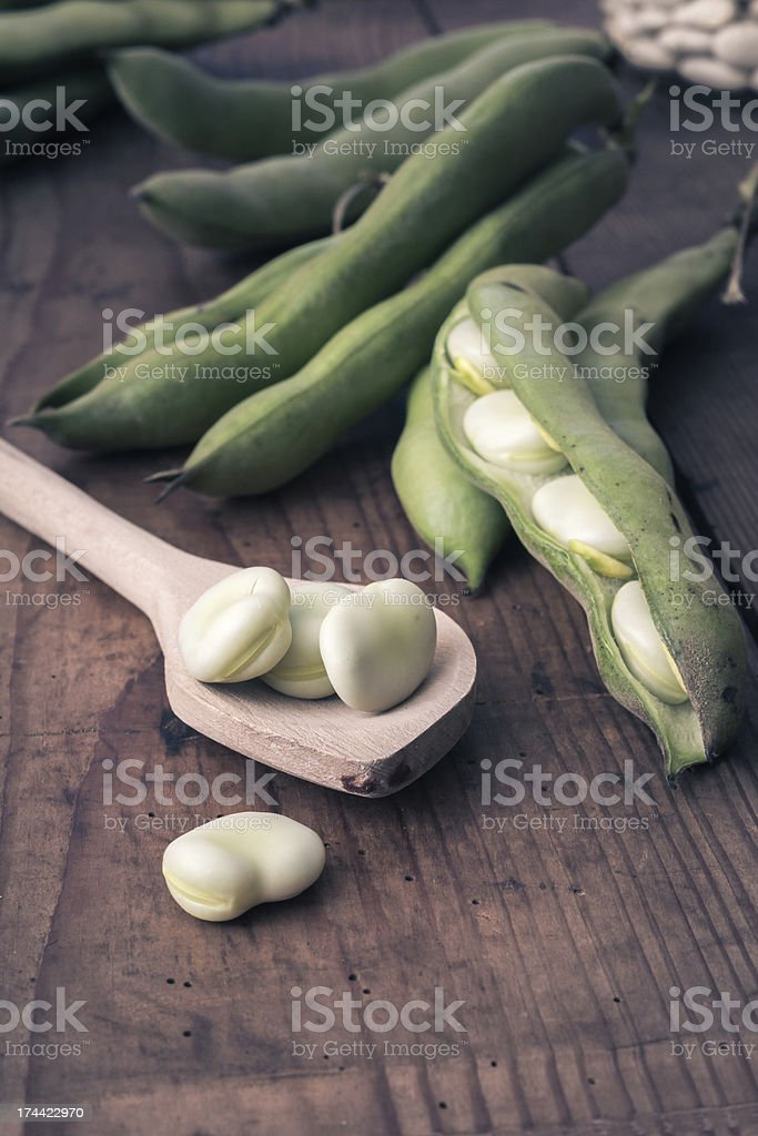 Broad Beans on a wooden Table with Jar royalty-free stock photo