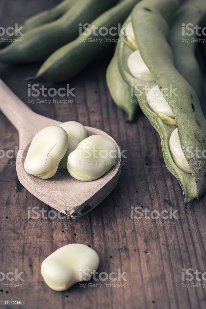 Broad Beans on a wooden Table with Spoon royalty-free stock photo
