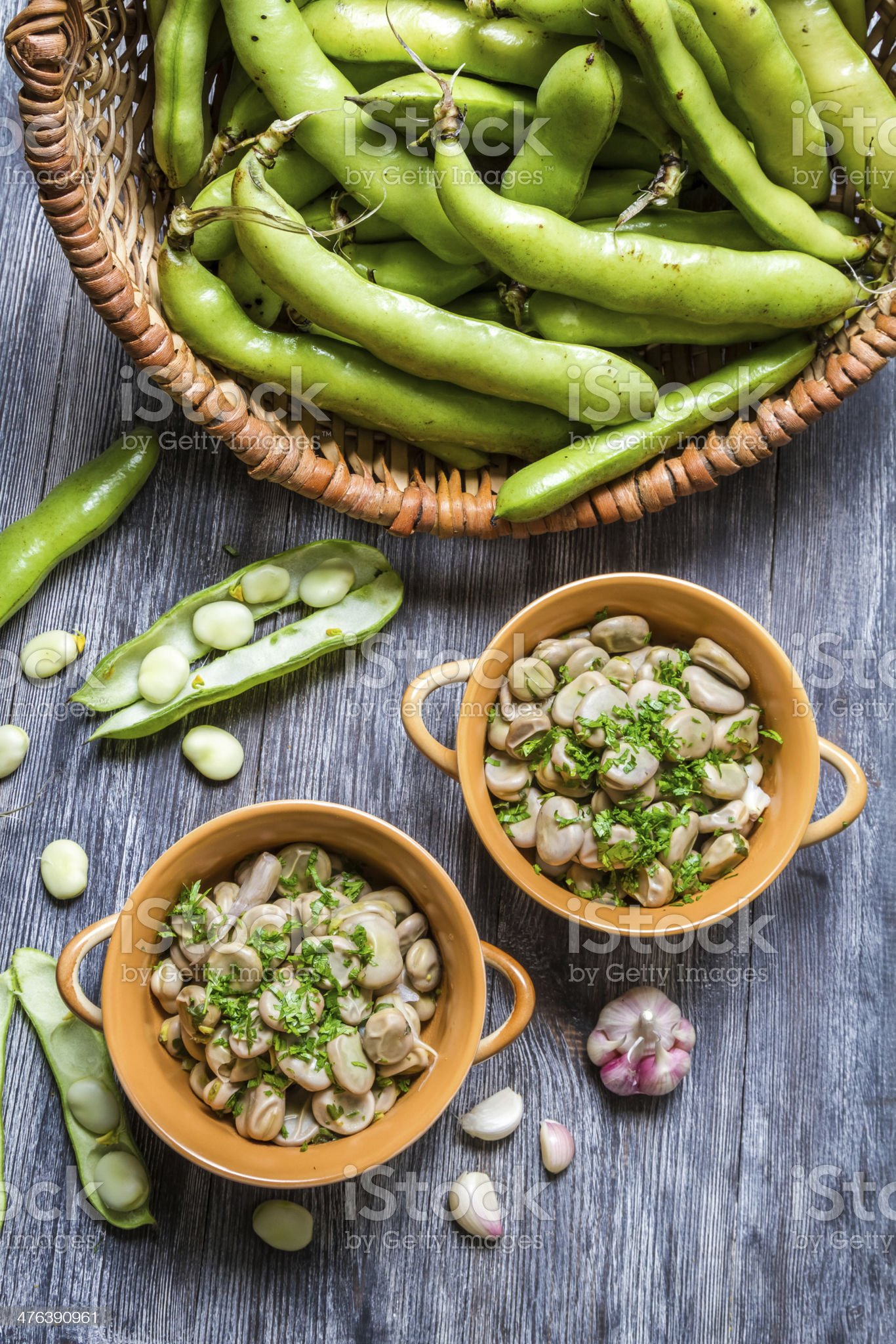 Broad beans served with parsley and garlic royalty-free stock photo