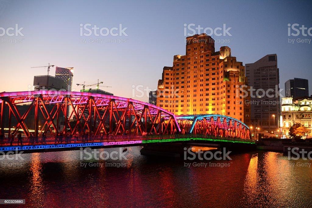 Broadway Mansions and Garden bridge at dusk, Shanghai, China stock photo