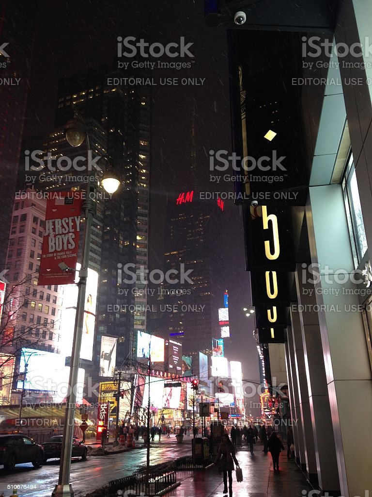 Broadway on Times Square at Night during Snow in Manhattan. stock photo