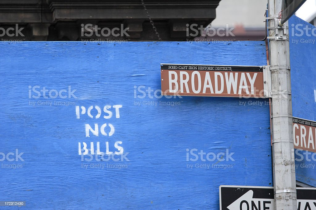 Broadway Sign Against POST NO BILLS royalty-free stock photo