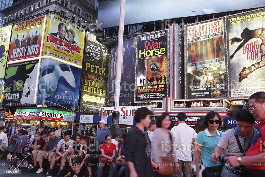 Broadway theater billboards and tourists Times Square NYC royalty-free stock photo