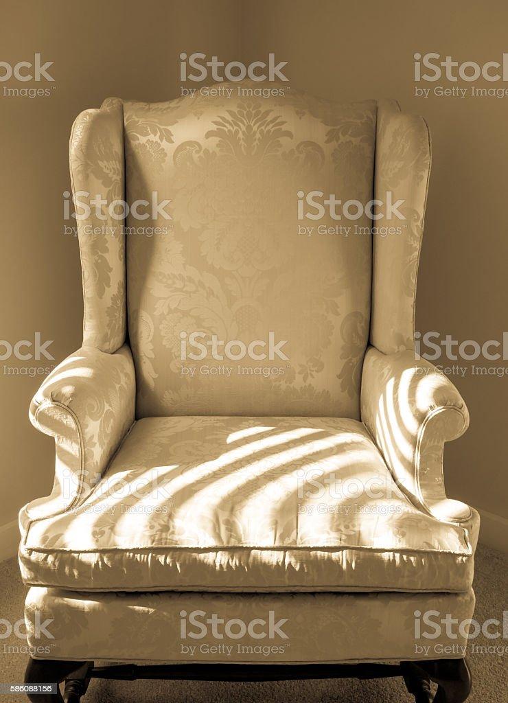 Brocade Chair in Corner of Room stock photo