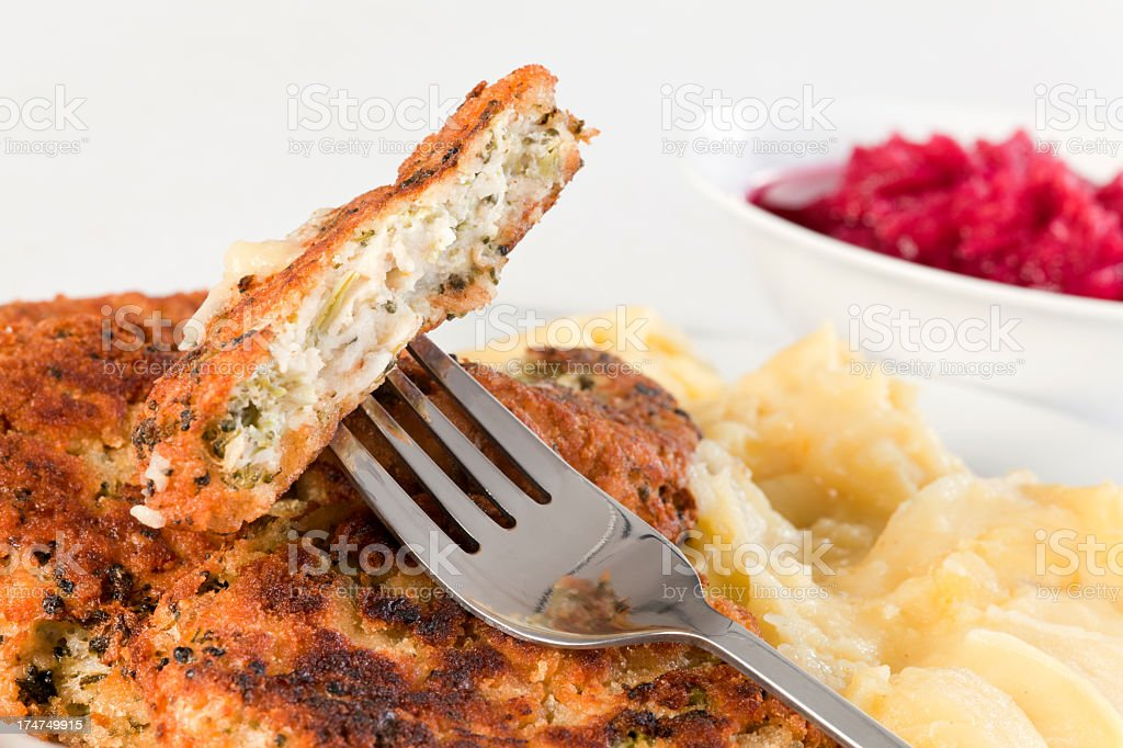 Broccoli and Buckwheat Pancakes on plate with potatoes. royalty-free stock photo